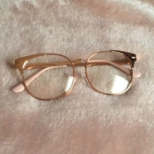 Claire's pink glasses